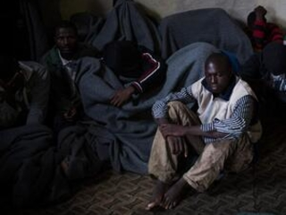 UN Libya migrant center plagued with crowding, TB, food cuts
