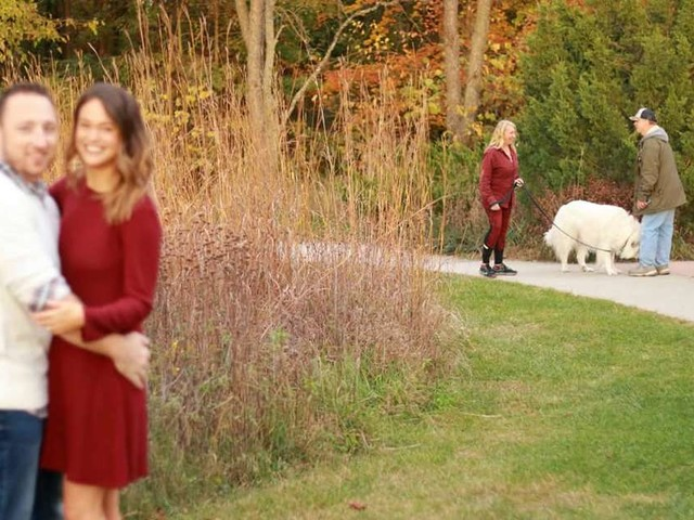 Photographer Gets A Little Distracted When She Spots A Dog