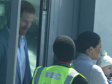 Meghan Markle Cradles Archie, 4 Mos., As Royal Family Arrives In South Africa For Press Tour