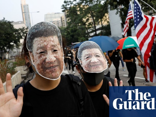 Hong Kong protesters defy ban on masks as they clash with police