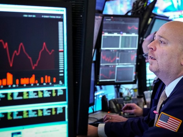 Stocks finish mixed as traders weigh weak economic data ahead of Fed speech