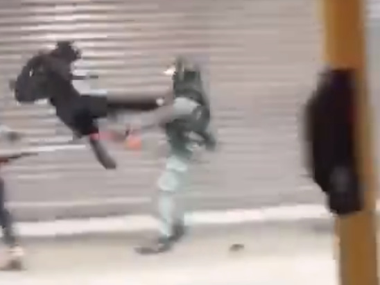 Watch: Hong Kong Cop Taken Out By Flying Drop-Kick To Stop Arrest