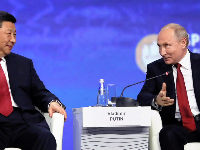 Putin and Xi Herald the Virtues of Globalism, Critiquing the U.S. on Trade