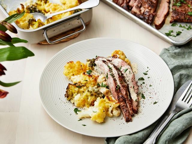 Flank steak with pepper sauce and cauliflower-broccoli gratin