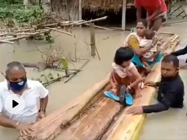 Assam MLA Walks In Waist-High Flood Waters To Rescue People