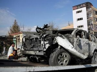 Afghan officials: Kabul car bomb killed 12, including kids