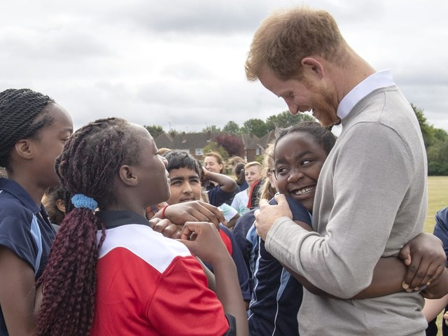 Prince Harry Hands Out Hugs and High Fives to a Group of Excited Students