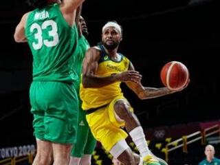 Mills leads Australia past Nigeria, 84-67 in Olympic opener