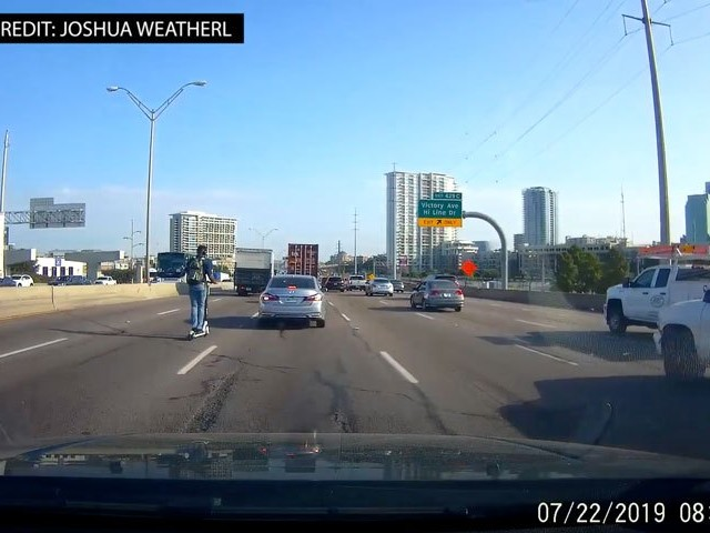 VIDEO: Man Seen Riding Electric Scooter On I-35E In Dallas During Morning Rush Hour