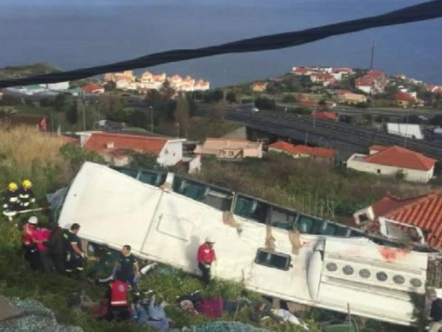 Portugal officials seek to identify 29 dead in bus crash