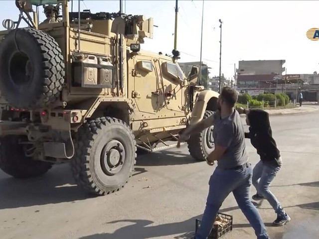 US troops leaving Syria pelted with potatoes