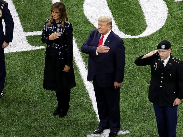 Minnesota 'teacher of the year' decided to kneel in protest at LSU Clemson game when she found out Trump was attending