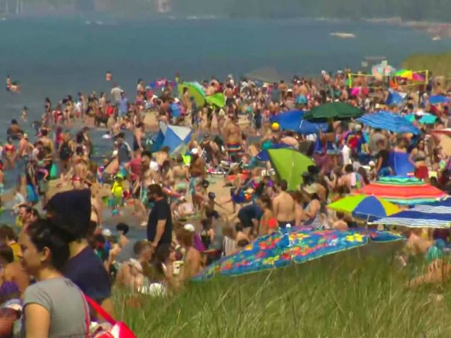 Photos show plenty of people flocked to beaches, but not a lot of social distancing or masks during the holiday weekend