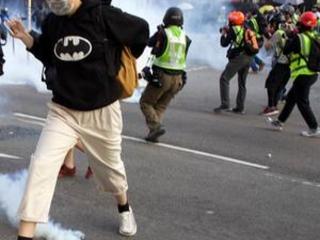 Hong Kong pro-democracy rally cut short by police tear gas