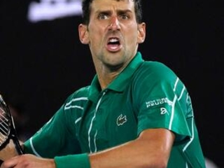 The Latest: Djokovic beats Federer, reaches Australian final