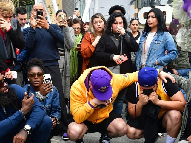 Photos and videos show makeshift Kobe Bryant memorials where fans are mourning the basketball legend who was killed in a helicopter crash on Sunday