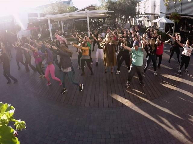Kourtney & Khloe Kardashian Surprise Kim With a Flash Mob