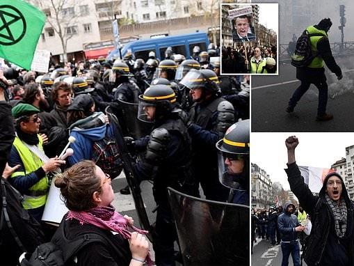 Paris police blast tear gas at Yellow Vest activists on anti-Macron march