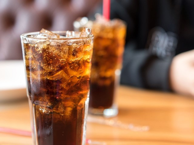 Environmentalists want Coca-Cola to ditch its plastic bottles. The company says people like them too much.