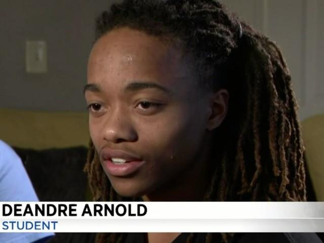 School reportedly tells black teen he must cut off his lengthy dreadlocks in order to walk for graduation