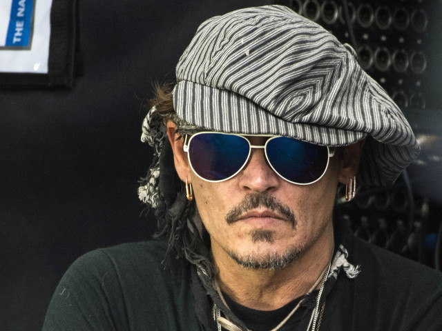 Johnny Depp Takes In Live Music at Glastonbury Music Fest After President Trump Remarks