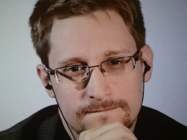 Edward Snowden wants to return to the US, but says the government won't promise him a fair trial
