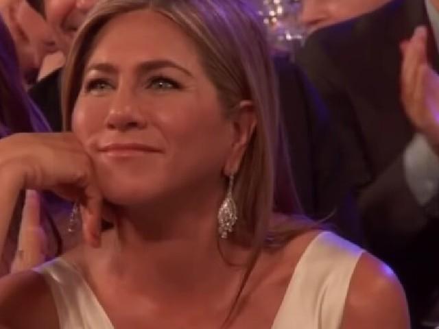 Brad Pitt clutching Jennifer Aniston's hand sparks all the rumors