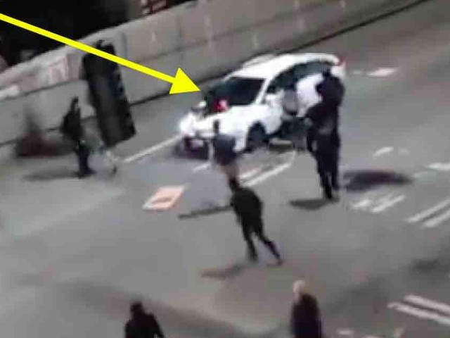 VIDEO: Antifa militant jumps on car's hood as fellow comrades close in. So the driver — reportedly an elderly man — hits the gas.
