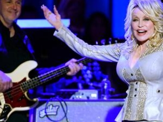 Still working '9 to 5,' Dolly Parton marks 50 years at Opry