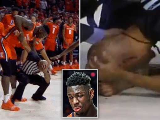 Frightening moment Illinois player ACCIDENTALLY levels an official with celebratory fist pump