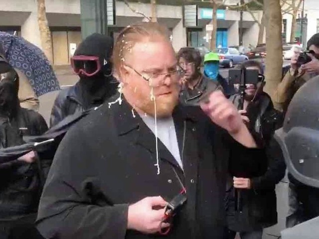 Antifa thugs gang up on journalist, pepper-spray him, jab him with umbrellas, kick and shove him down sidewalk — while cops 'stand by and do nothing'