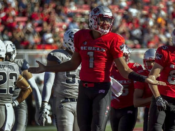 Ahead of must-win game, Rebels quiet on quarterback decision