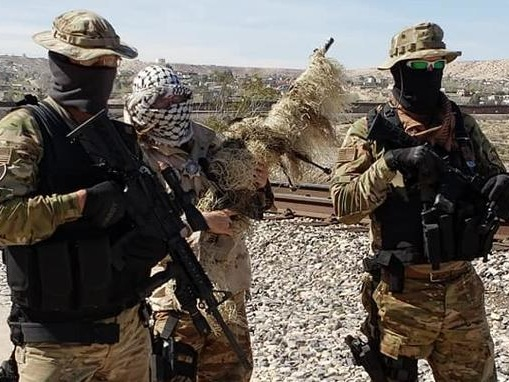 Armed Militia Rounding Up Migrants At Southern Border
