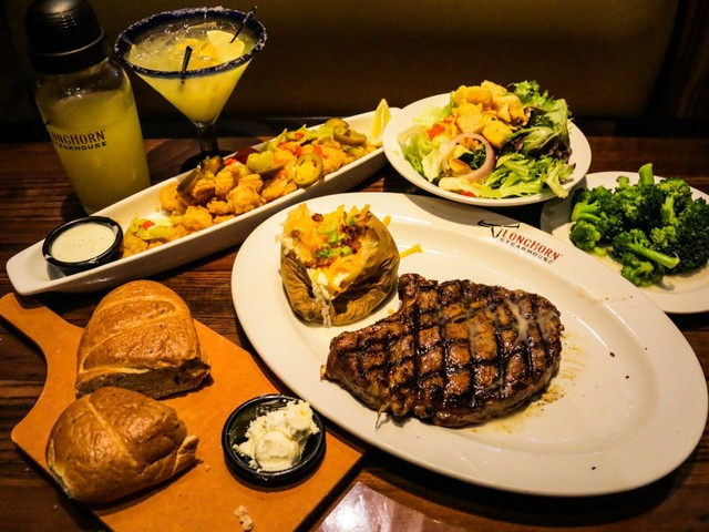 I ate the same meal at Outback and LongHorn Steakhouse to see which would do it better, and the winner was superior in every way except service