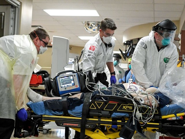 Hospitals inundated with coronavirus patients pulled in cardiologists, anesthesiologists, and other workers to help in ICUs