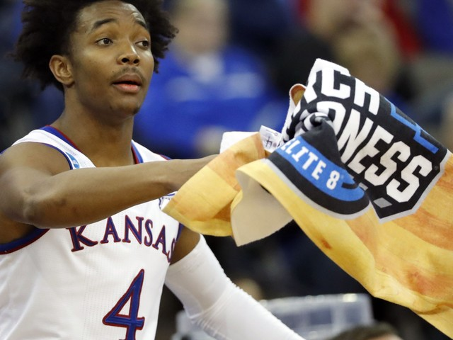 NCAA Latest: Kansas moves on after holding off Clemson