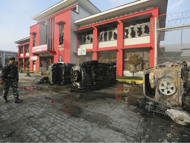 Inmates set fire to prison during riot in Indonesia