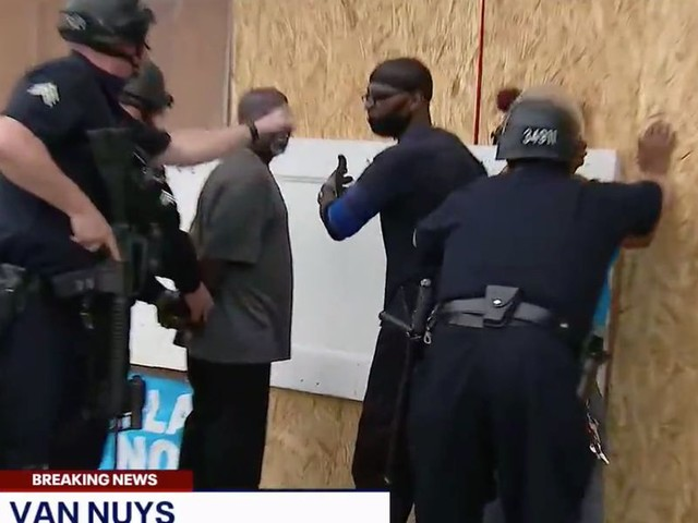 LAPD detains armed business owners on live TV. The business owners were just trying to protect their stores from looters.