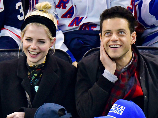 Rami Malek and Lucy Boynton have date night at Rangers game