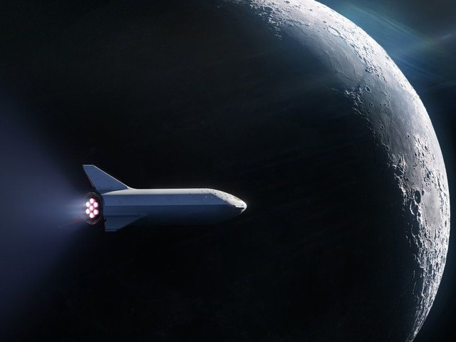 SpaceX says it will send someone around the Moon on its future monster rocket