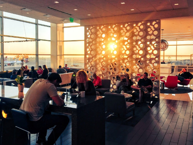 Crowding pushes airport lounges to raise prices, limit access