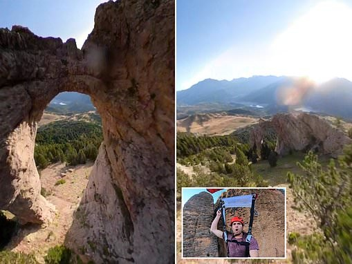 Duck! Wingsuit pilot flies through a 10ft rock arch at 142mph in heart-stopping footage