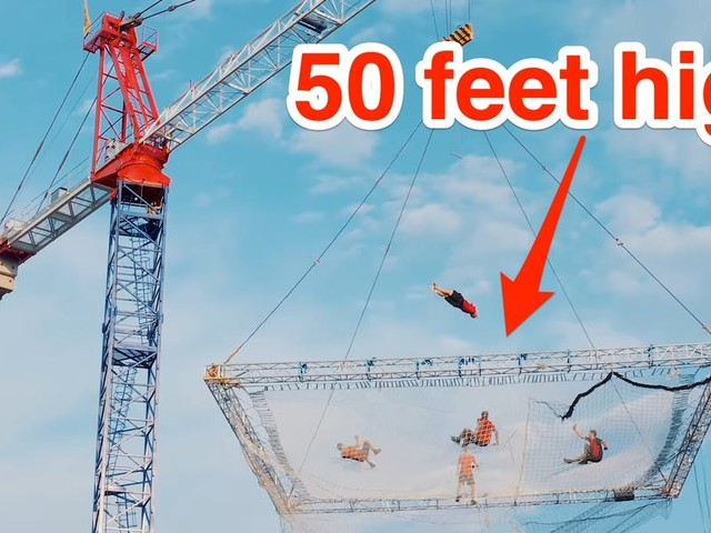 A group of Slovenian acrobats made the world's largest trampoline suspended 50 feet in the air, but they had to take it down when rain threatened to tip it over