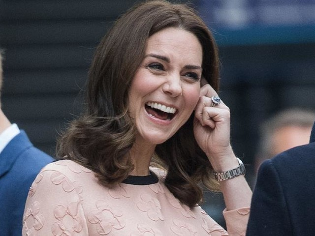 Kate Middleton Dances With Paddington Bear and Shows Off Her Growing Bump