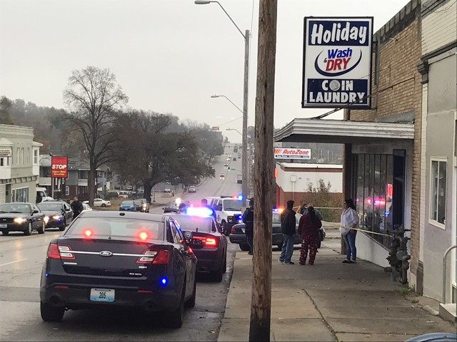 Police standoff with person of interest in laundromat shooting ends after man surrenders