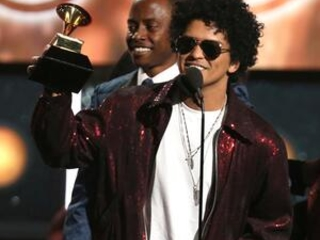 Partial list of winners in top categories at the Grammys