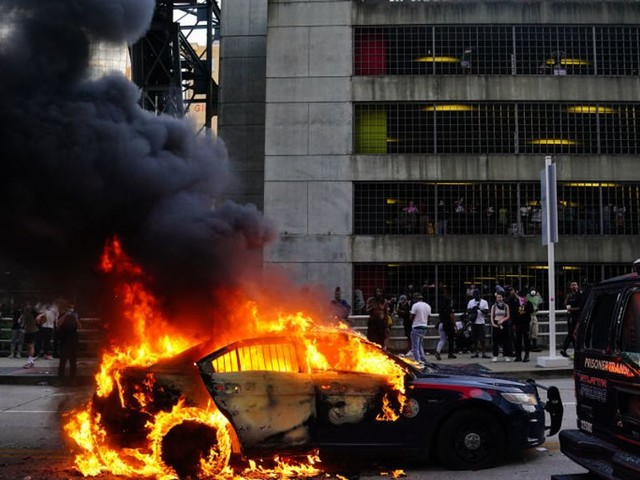 VIDEO: Fiery riots erupt in cities across the country as tensions flare and protests turn violent