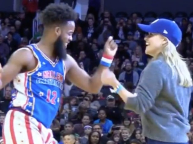 You Have to See Reese Witherspoon Enthusiastically Dancing With the Harlem Globetrotters