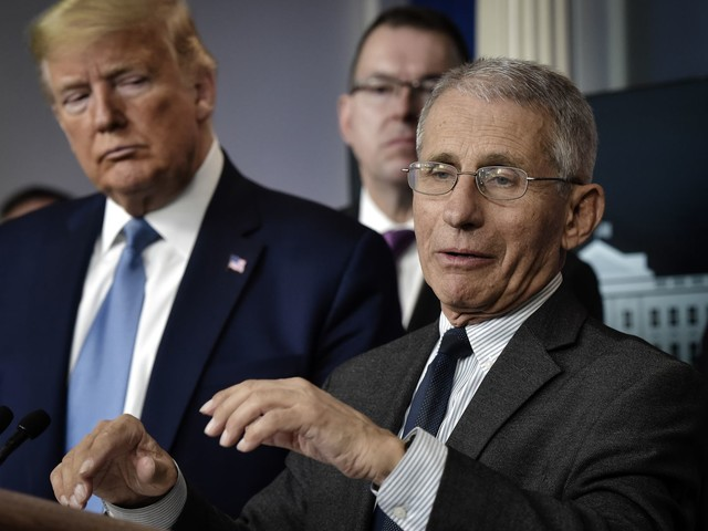 As Trump signals readiness to break with experts, his online base assails Fauci