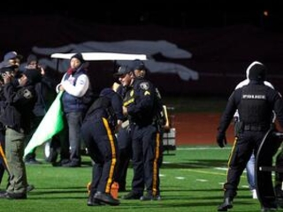 Alleged gunman, 4 others charged in football game shooting